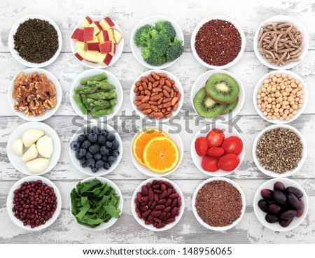 Large super food selection in white porcelain dishes over distressed white wooden background. Stock photo ©