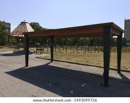 large table to the large chair in the park