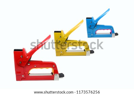 Large tacker or metal stapler colorful for repair work on the house isolated on white background.
