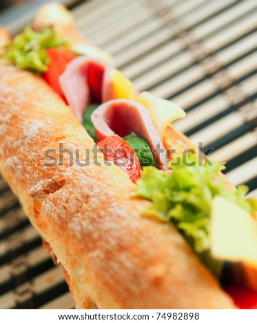Large tasty sandwich on a textered background