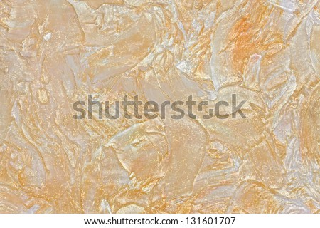 large texture of wall painted beige with gloss and glitter