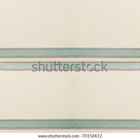 Large textured paper background with antique ribbon.