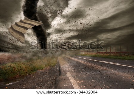 Large tornado over a road