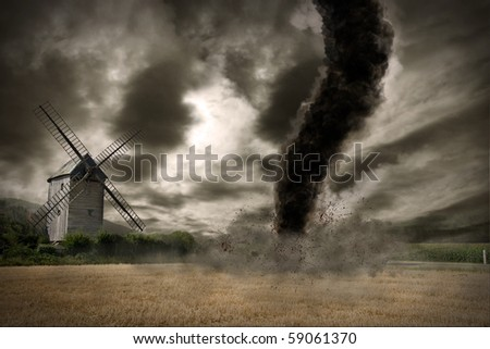 Large tornado over a wind mill - stock photo