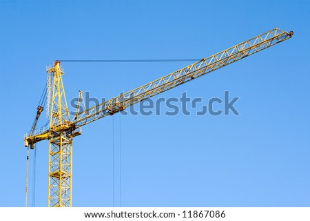 Large tower crane at building site on a background of sky