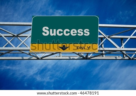Large traffic billboard the word success on it