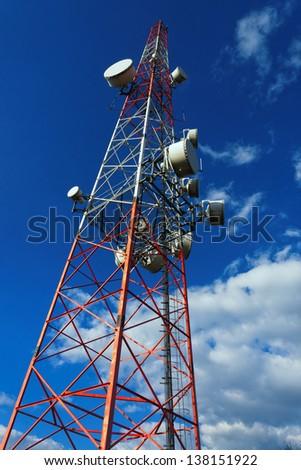 Large transmission tower against sky