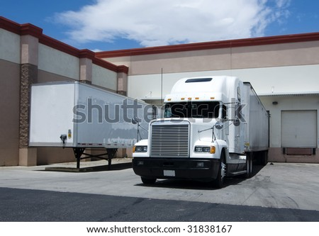 large truck unloading at warehouse bay stock photo 31838167