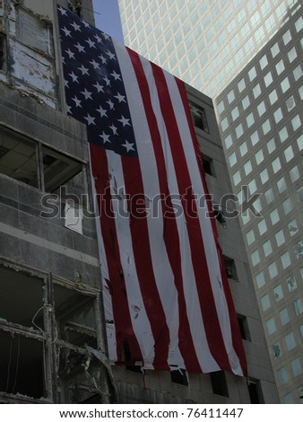 Large US Flag on building across from Ground Zero WTC taken on 9-18-2001  (left of WFC fallen atrium glass dome)