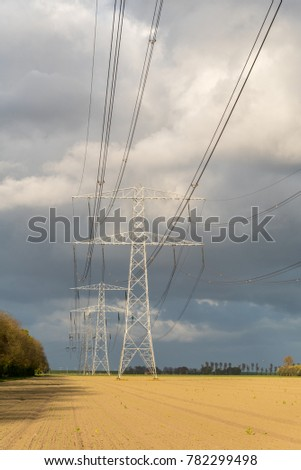 Large view on the modern high powerlines on the field #782299498