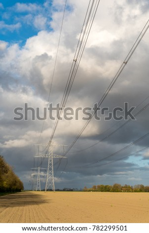 Large view on the modern high powerlines on the field #782299501