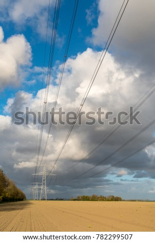 Large view on the modern high powerlines on the field #782299507