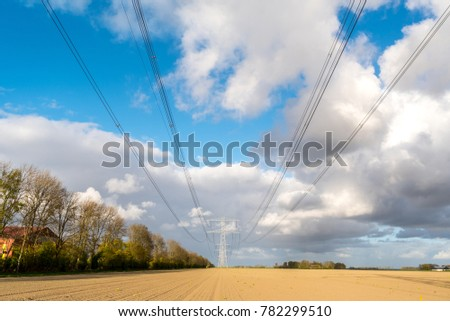 Large view on the modern high powerlines on the field #782299510