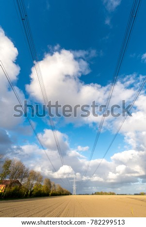 Large view on the modern high powerlines on the field #782299513
