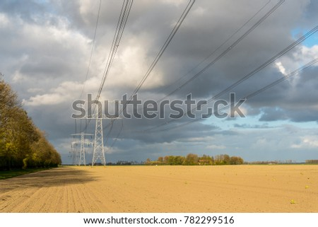 Large view on the modern high powerlines on the field #782299516