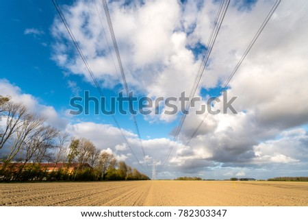 Large view on the modern high powerlines on the field #782303347