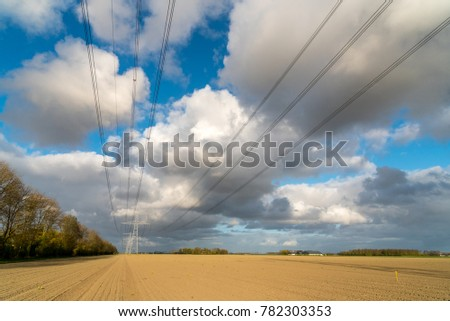 Large view on the modern high powerlines on the field #782303353