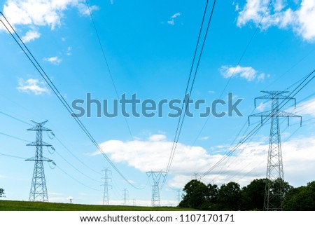 Large view on the powerline on the field #1107170171