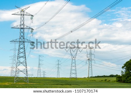 Large view on the powerline on the field #1107170174