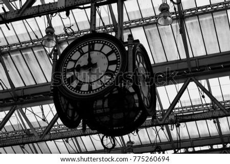 large vintage clock hanging...