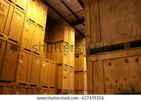 Large Warehouse of Big Wood Storage Crates #627439256