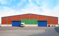 Large warehouse with two sliding gates.