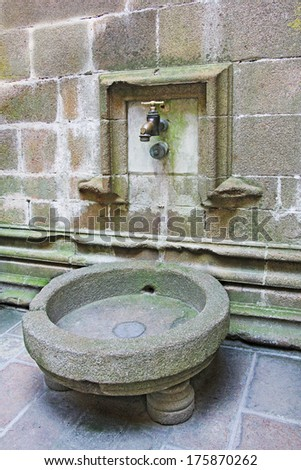 Large water tap in the monastery Mont Saint Michel, Normandy, France