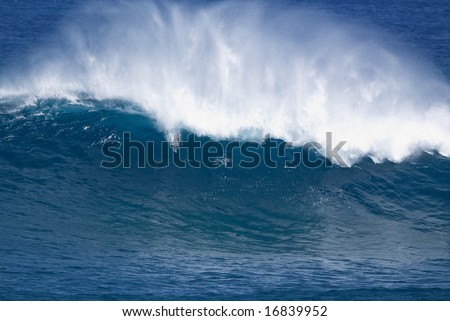 Large Wave breaking at Jaws in Maui Hawaii home break for Laird Hamilton