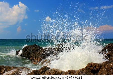 Large wave crash against the rocks during a storm in the tropics