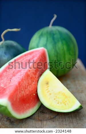 Large wedge of fresh red  and yellow juicy Watermelon and whole watermelon