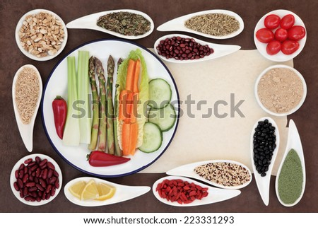 Large weight loss diet health food selection in porcelain bowls over parchment and brown paper background.