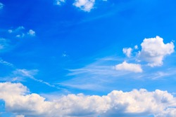 Large white air cloud in the blue sky. The weather forecast reports on partly cloudy weather and a change from cyclone to anticyclone. Environmentally friendly source of energy. Wallpaper banner.