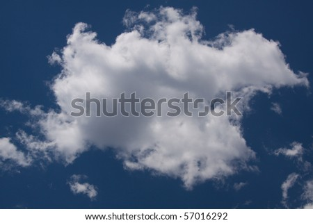 Large White Cloud on Blue Background