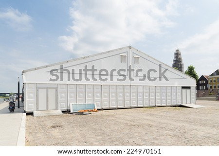 large white event tent under a sunny sky #224970151