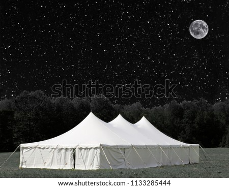 large white events tent under a star filled sky (some elements courtesy of nasa) #1133285444