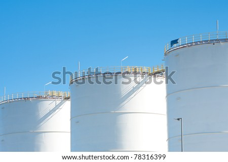 large white tanks for petrol and oil in the Rotterdam harbor