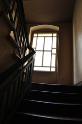 large window staircase in a tenement house decorative railing