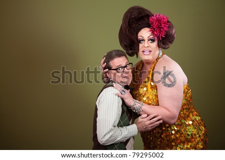 Large woman holding a uncomfortable nerd on green background