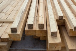 Large wooden beams for construction. Building material. Sawed beam