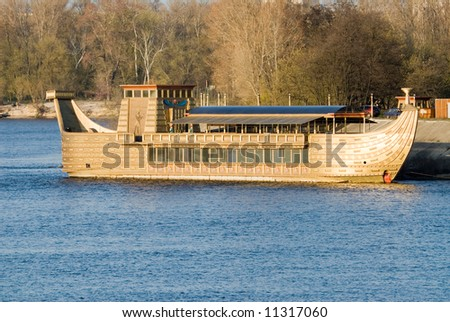 Large wooden boat on the blue water