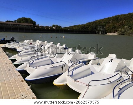 large wooden pier for pleasure boats on the river or open pond in summer