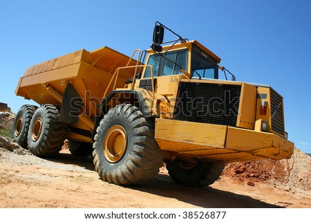 Large yellow earth mover construction truck