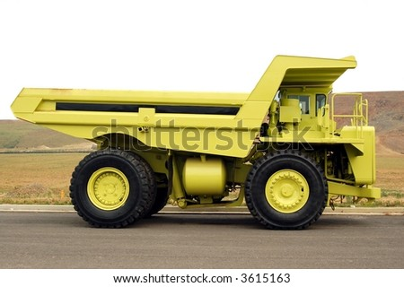 Large Yellow Quarry Truck, Top of image is isolated on white so that you can place your object in the truck bed