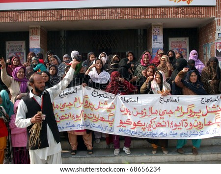 LARKANA, PAKISTAN - JAN 09: Activists of National Lady Health Workers Employees Union chant slogans in favor of their demands during a protest demonstration on January 09, 2011in Larkana. - stock photo