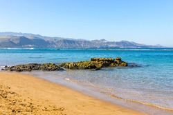Las Canteras Beach (Playa de Las Canteras) in Las Palmas de Gran Canaria city, Canary island, Spain. Long beach with natural barrier reef in 200 metres from the shore, which protects it from the tides