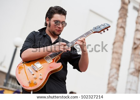 LAS PALMAS, SPAIN-APRIL 13: Carlos Ayala (Charly) in Tennessee Three, from Canary Islands, perform onstage during a charity for Sahara on April 13, 2012 in Las Palmas, Spain
