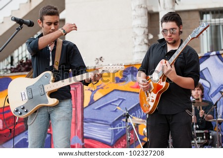 LAS PALMAS, SPAIN-APRIL 13: Carlos Ayala(r) and James Vidal(l) in Tennessee Three, from Canary Islands, perform onstage during a charity for Sahara on April 13, 2012 in Las Palmas, Spain
