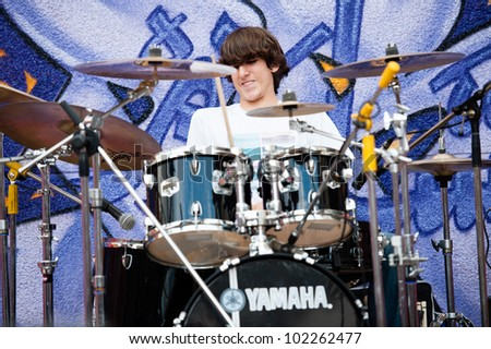 LAS PALMAS, SPAIN-APRIL 13: Drummer Carlos Franquiz Gamez of group Wings of Volund, from Canary Islands, perform during a charity for Sahara on April 13, 2012 in Las Palmas, Spain - stock photo