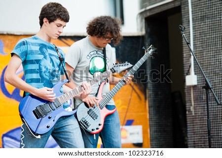 LAS PALMAS, SPAIN-APRIL 13: Saulo Santana Llarena(l) and Alejandro Alvarez(r) in Runaway Train, from Canary Islands, perform onstage during a charity for Sahara on April 13, 2012 in Las Palmas, Spain