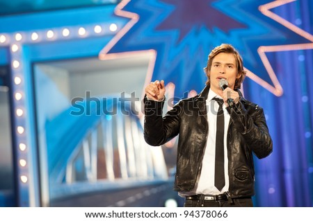 LAS PALMAS, SPAIN - FEBRUARY 3: Singer and television host Carlos Baute from Caracas in Venezuela performs onstage during the carnival Queens Gala on February 3, 2012 in Las Palmas, Spain.